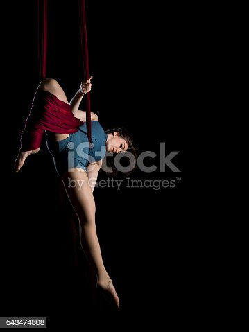 629965740 istock photo Aerial dancer woman isolated on black 543474808
