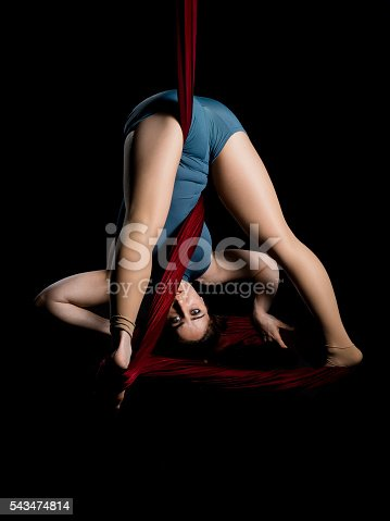 629965740 istock photo Aerial dancer woman isolated on black 543474814