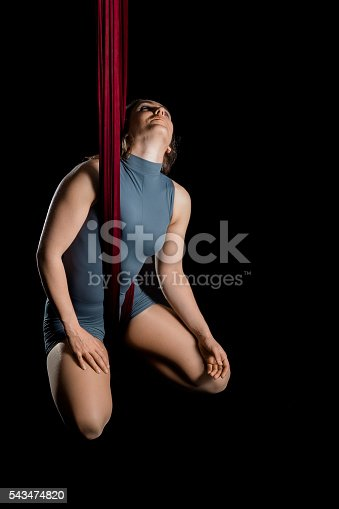 629965740 istock photo Aerial dancer woman isolated on black 543474820