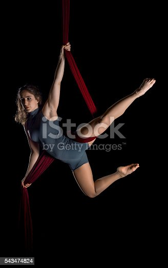 629965740 istock photo Aerial dancer woman isolated on black 543474824