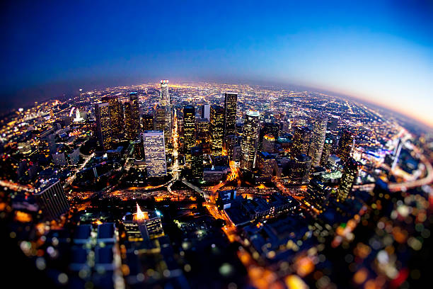 Aerial Downtown Los Angeles at Night Aerial shot of downtown Los Angeles, CA at night. Photographed with fish-eye lens. Some noise due to low light and high ISO. Shot from R22 helicopter. fish eye lens stock pictures, royalty-free photos & images