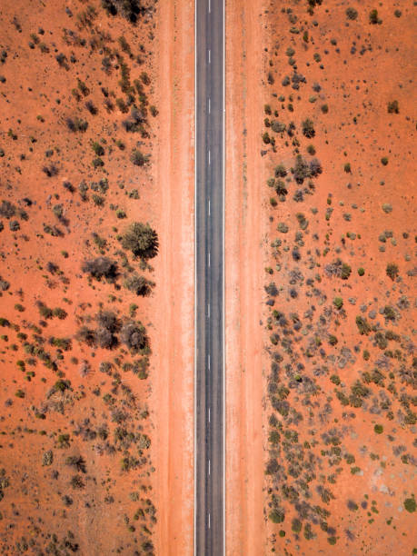 Aerial Drone Bird's eye view on a scenic highway in the outback of South Australia Shot with the DJI Mavic Pro outback stock pictures, royalty-free photos & images