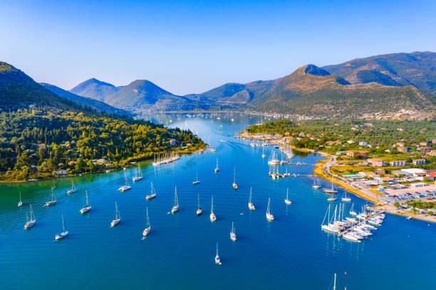 Aerial drone bird's eye view photo of iconic port of Nidri or Nydri, Leflkada island, Ionian, Greece stock photo