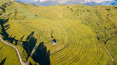 Aerial drone landscape of the meadows at high altitudes, forming soft hills. Dolomites, Alta Badia, Sud Tirol, Italy