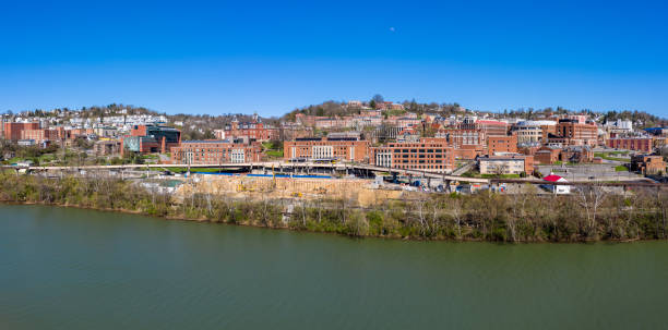 Aerial drone panorama of the campus of the university in Morgantown, West Virginia Aerial drone panoramic shot of the empty downtown campus of WVU in Morgantown West Virginia during the coronavirus shutdown monongahela river stock pictures, royalty-free photos & images