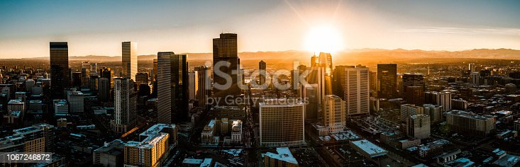 A beautiful drone photo of Denver Colorado skyline at sunset