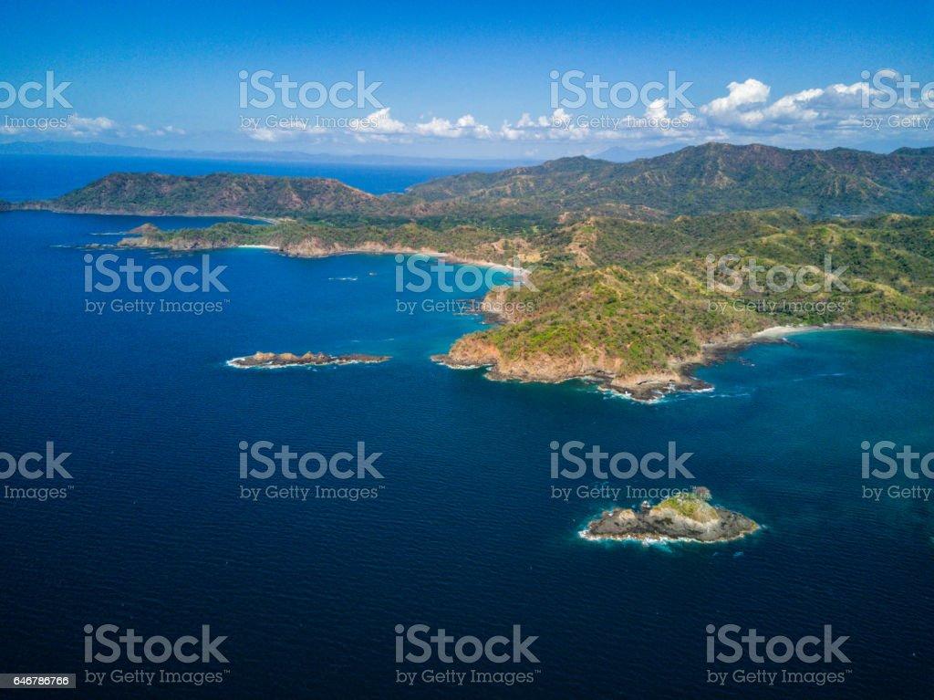 Aerial drone photo.  Costa Rica coastline, rugged mountains & jungles stock photo