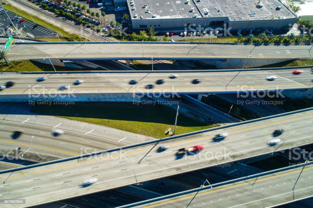 Aerial drone photo of fast cars in motion on a highway interchange stock photo