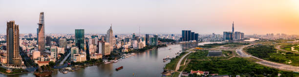 Aerial drone photo - Skyline of Saigon (Ho Chi Minh City) at sunrise. Vietnam stock photo