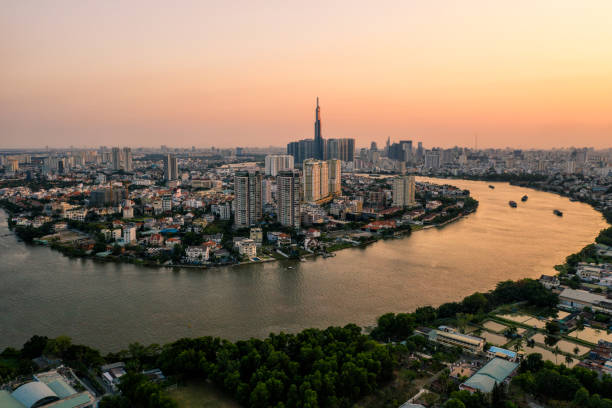 Aerial drone photo - Skyline of Saigon (Ho Chi Minh City) at sunset. Vietnam stock photo