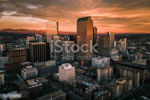 A fiery sunrise over the skyline of Denver