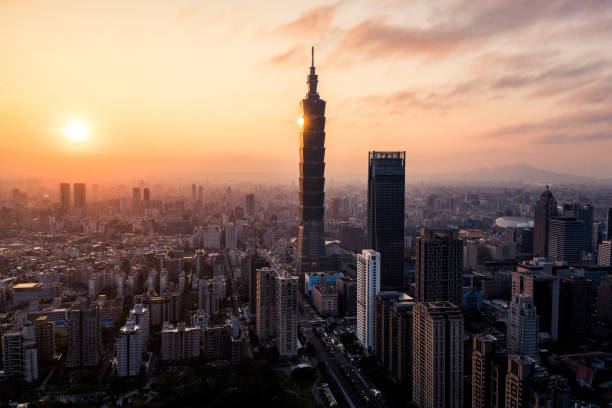 Aerial drone photo - Sunset over Taipei skyline. Taiwan. Taipei 101 skyscraper featured. stock photo