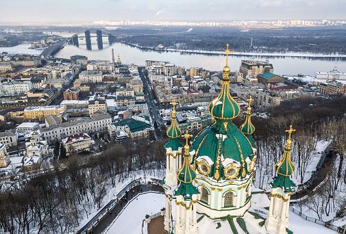KYIV,UKRAINE-18 FEBRUARY,2018:Aerial drone photo of winter Kiev center.Traditional christian orthodox Saint Andrews Church.Beautiful religious building on Andriivskiy hill