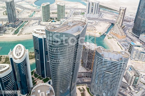 Aerial drone shot of skyscrapers and towers in the city - Abu Dhabi Al Reem island towers - Abu Dhabi, UAE, May 30, 2019