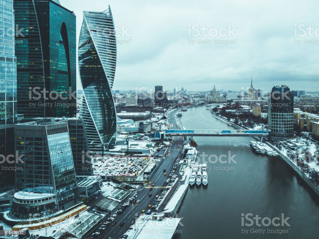 aerial drone shot of the city skyscraper near the river and bridge during winter't'n stock photo