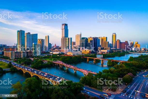 Aerial drone view above austin texas usa afternoon sunset lady bird picture id1160610871?b=1&k=6&m=1160610871&s=612x612&h=tpw9ez2xcmchsv7trkfhf0im0kl8uzh9pbihoab8b2y=