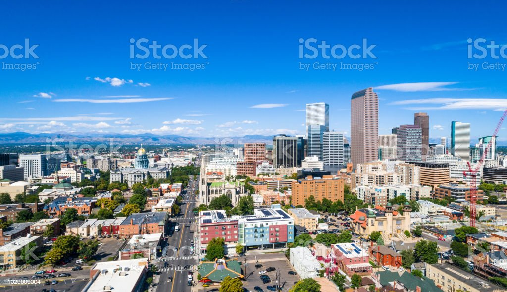 aerial drone view above Denver Colorado skyline cityscape blue sunny day state capital building and historic old side wide view stock photo