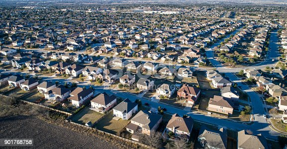 istock Aerial drone view above Suburb homes in residential neighborhood 901768758