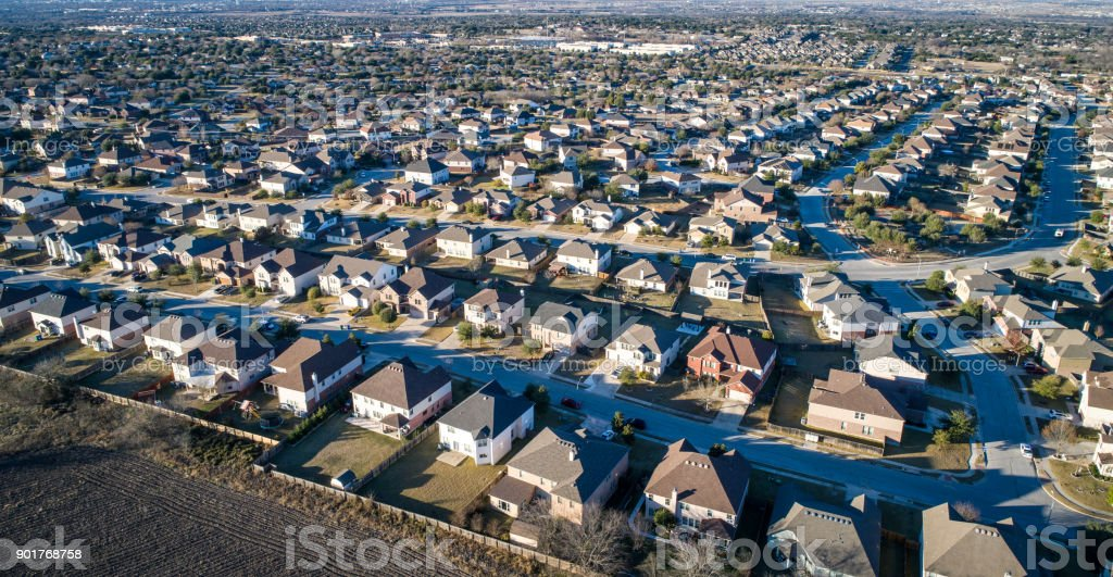 Aerial drone view above Suburb homes in residential neighborhood stock photo