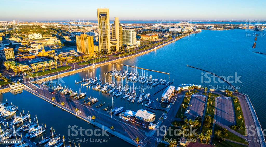 Aerial Drone View Corpus Christi , TX Bayfront at sunrise long shadows behind the Twin Towers and Harbor Bridge with T-Head stock photo
