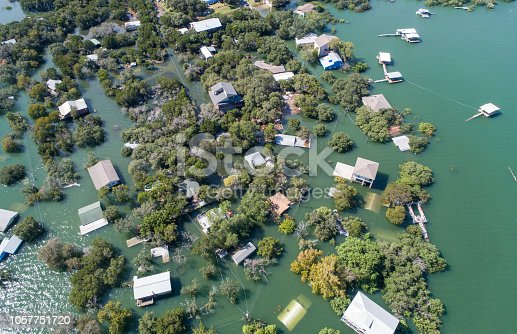 istock Aerial drone view entire Neighborhood under water near Austin , Texas 1057751720