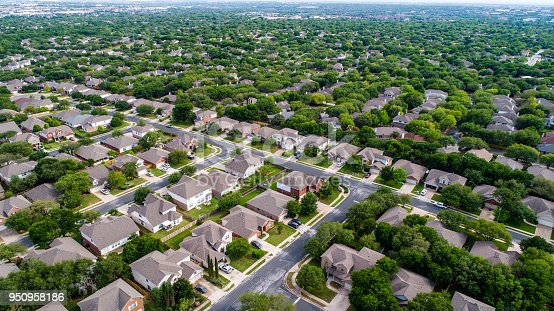 istock Aerial drone view high above suburb homes in Austin , Texas 950958186