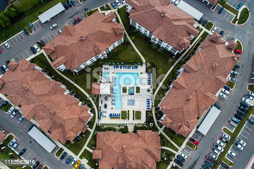 istock Aerial drone view looking down from above Large Orange Apartment complex in Austin , Texas 1153563916