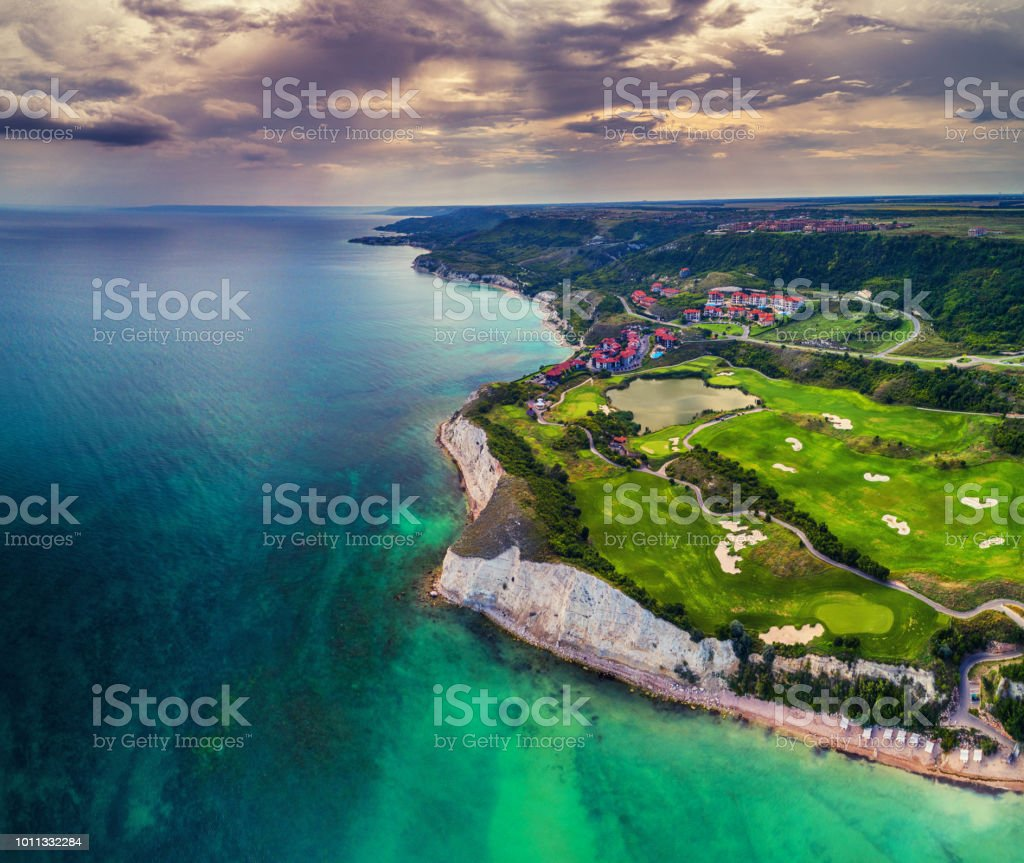 Aerial drone view of a golf course next to the cliffs and Black sea. Golfing fields landscape. stock photo
