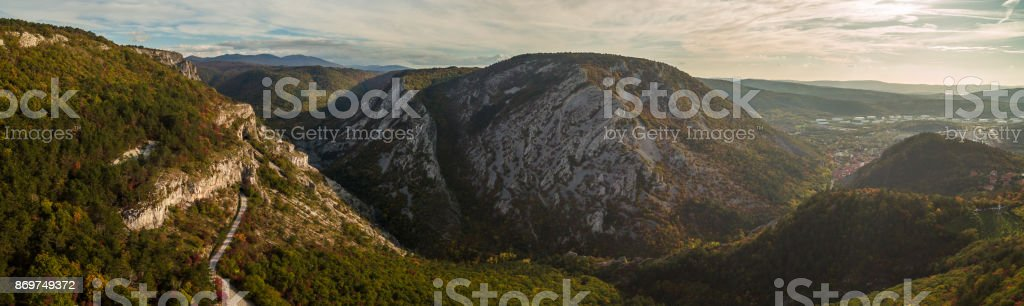 Aerial drone view of amazing autumn colors in fall forest. Val Rosandra (Glinscica) Trieste Italy stock photo