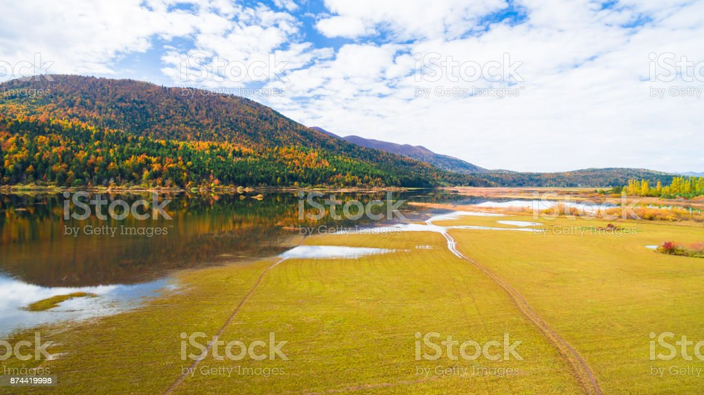 Aerial drone view of amazing autumn colors on the lake. Cerknisko lake, Slovenia stock photo