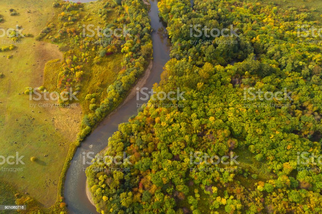 Aerial drone View of autumn mountains and small river with forests in sunrise soft light – zdjęcie