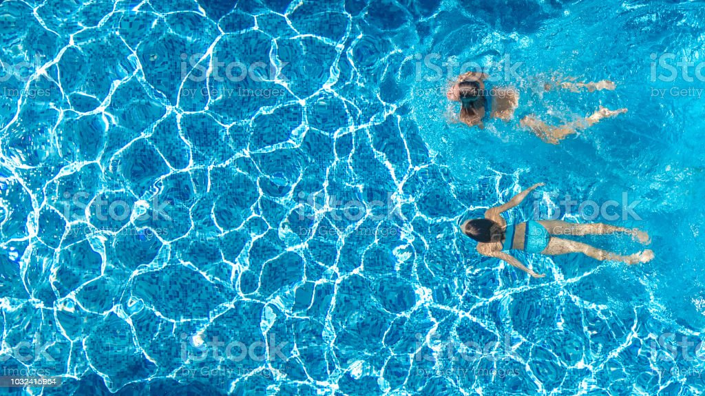 Aerial drone view of girls in swimming pool water from - Swimming pool girl christmas vacation ...