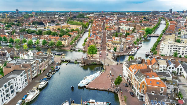 Aerial drone view of Leiden town cityscape from above, typical Dutch city skyline with canals and houses, Holland, Netherlands Aerial drone view of Leiden town cityscape from above, typical Dutch city skyline with canals and houses, Holland, Netherlands leiden stock pictures, royalty-free photos & images