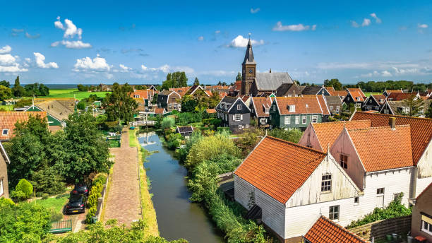 Aerial drone view of Marken island, traditional fisherman village from above, typical Dutch landscape, North Holland, Netherlands Aerial drone view of Marken island, traditional fisherman village from above, typical Dutch landscape, North Holland, Netherlands nederland stock pictures, royalty-free photos & images