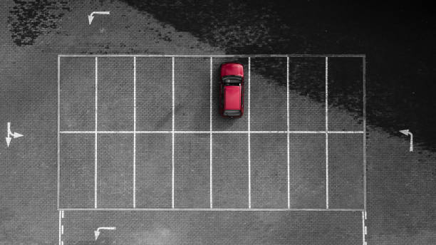 Aerial drone view of one red car parked stock photo