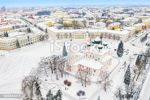istock Aerial drone view of Orthodox Church of Elijah the Prophet and old city center in winter of Yaroslavl, Russia. Ancient russian city of the touristic Golden Ring. 1300544415