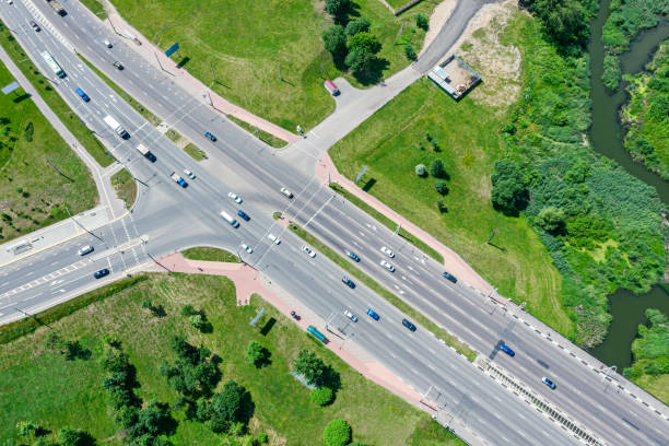 aerial drone view of suburban street intersection with car traffic stock photo