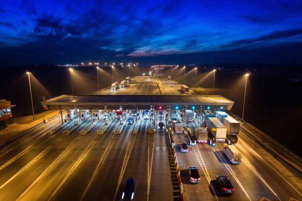 Aerial drone view on toll collection point on motorway at night. stock photo