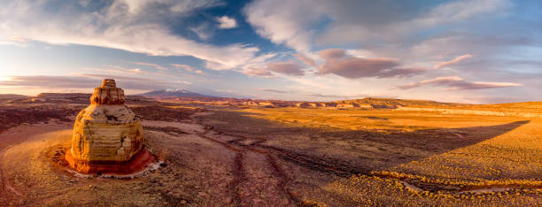 Aerial Drone View Panoramic Of Church Rock, Utah, At Sunset Aerial pano of Church Rock just outside Moab Utah, at sunset navajo sandstone formations stock pictures, royalty-free photos & images