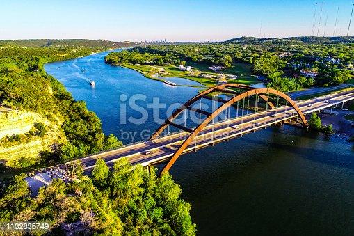 501329818istockphoto aerial drone view pennybacker bridge Austin Texas at sunset green spring landscape 1132835749