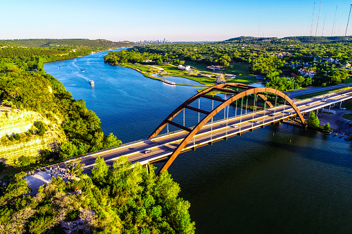501329818 istock photo aerial drone view pennybacker bridge Austin Texas at sunset green spring landscape 1132835749