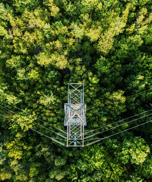 Aerial Drone View: Power Pylon Aerial view of a high voltage power pylon. power line stock pictures, royalty-free photos & images