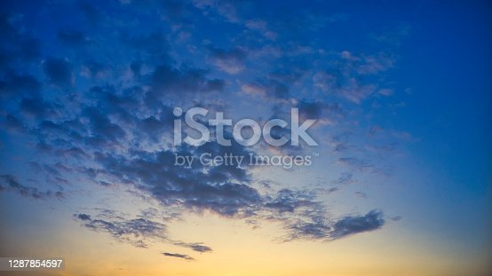 Aerial drone view Sky with cloud and sun ray yellow and blue color background. With copy space for text or design.