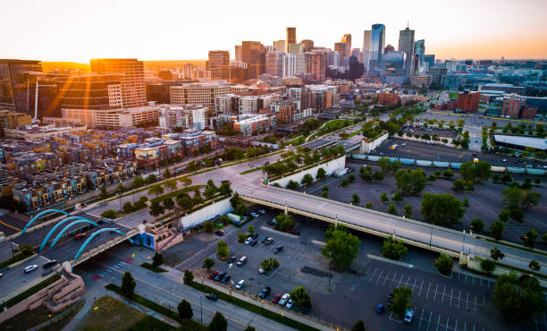 aerial drone view Sun beams and Sun rays beaming across horizon in Perfect Denver Colorado Skyline Cityscape high above Mile High City Perfect Golden Hour landscape of the growing modern city of Denver , bridges and highways and newly developed cityscape , aerial drone view Sun beams and Sun rays beaming across horizon in Perfect Denver Colorado Skyline Cityscape high above Mile High City denver stock pictures, royalty-free photos & images