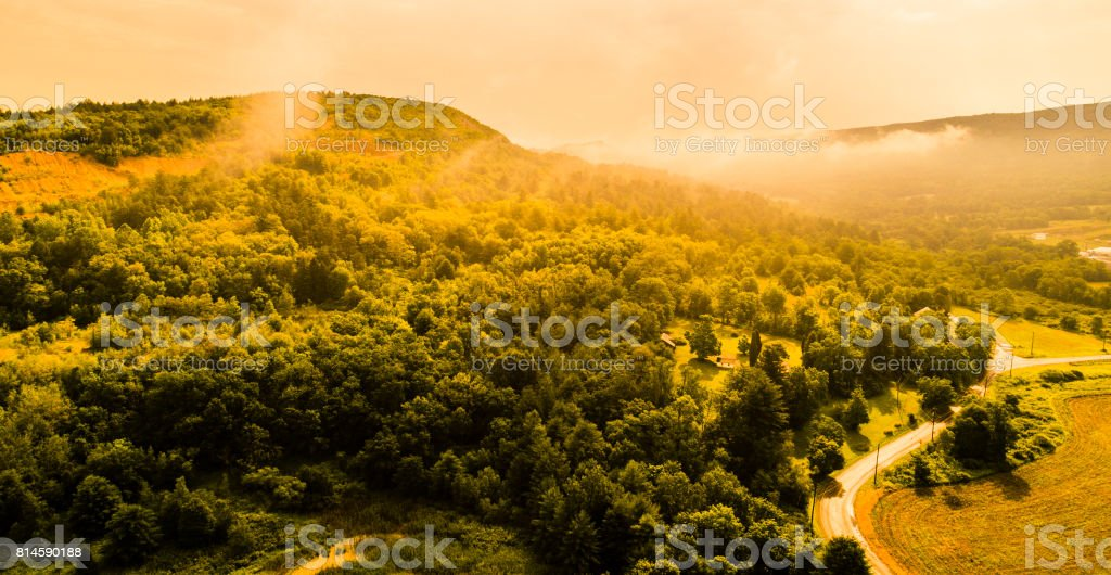 Aerial drone view to the Blue Mountains covered by low clouds, Poconos, Pennsylvania, at the early morning. stock photo
