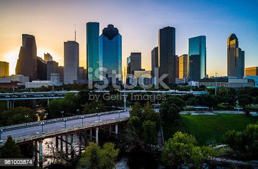 542727462 istock photo Aerial Drone View With Sabine Street Bridges Sunrise in Houston Texas Skyline Cityscape 981003874