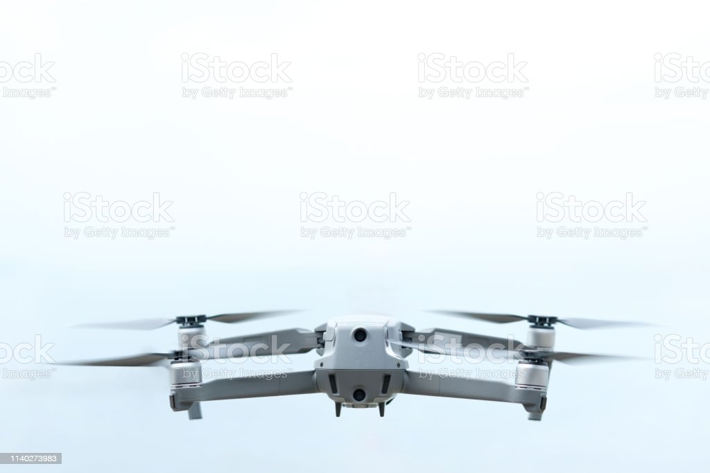 Aerial equipment Drone with Digital Camera on the White and blue...