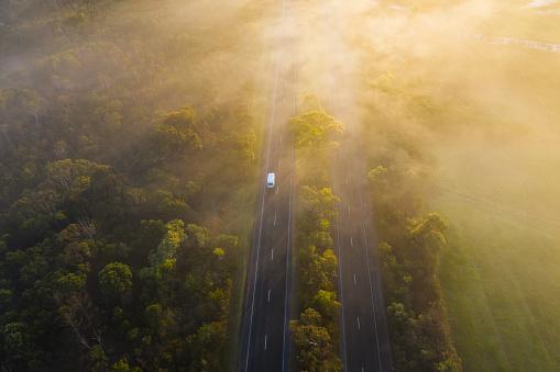 istock Aerial - Fog over Country Road in Victoria Australia on Sunrise 1172710364
