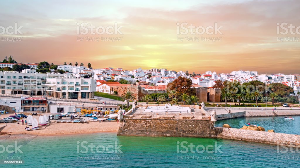 Aerial from the city Lagos with the Forte da Bandeira in Portugal at sunset stock photo