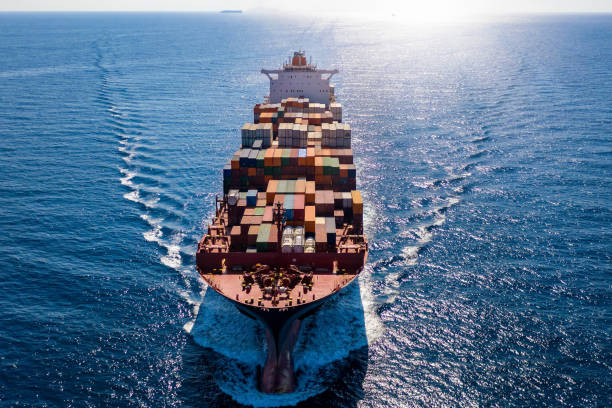 Aerial front view of a container cargo ship on open sea stock photo